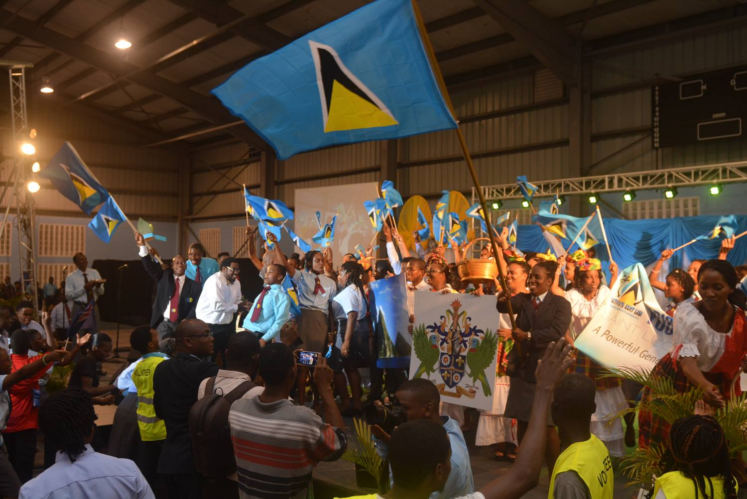 Seventh-day Adventist Youth from St. Lucia was their flags and hold banners at the Beausejour Auditorium in Castries, as they welcome the rest of youth congress delegation from neighboring islands in the Caribbean. The congress drew nearly 1,000 young people for one week of service in communities and one of leadership training from July 19 to August 1, 2015. Images by Jabarrio Mykel Holligan